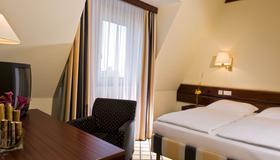 斯图加特瑞拉科萨酒店 - 柏林 - 睡房