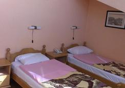 Hotel Ideal - 波德戈里察 - 睡房