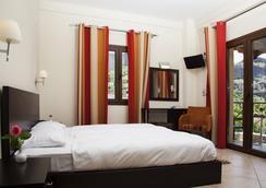 迈特奥雷迪斯酒店 - 卡兰巴卡 - 睡房