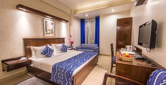 罗克兰酒店 - 新德里 - 睡房