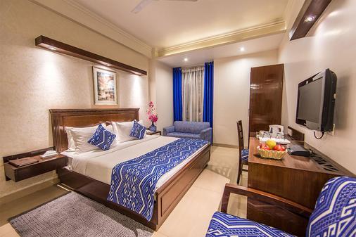 罗克兰帕尔克酒店 - 新德里 - 睡房
