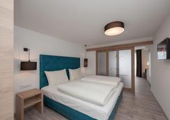 贝格威尔特酒店 - 朗根费尔德 - 睡房