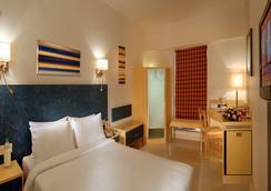 居家酒店 - 昌迪加尔 - 睡房