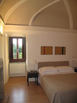 卡萨曼夏酒店 - 福利尼奥 - 睡房