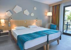 图伊布鲁棕榈园酒店 - 式 - 马纳夫加特 - 睡房