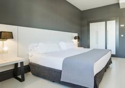 毕尔巴鄂伊鲁宁酒店 - 毕尔巴鄂 - 睡房