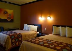 蓝海湾酒店及套房 - 南帕诸岛 - 睡房