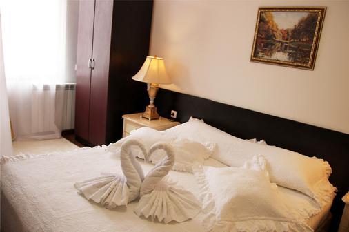 优雅豪华酒店 - 班斯科 - 睡房