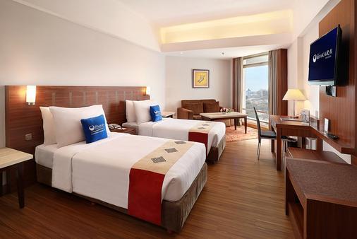毕达卡拉班芝兰大酒店 - 南雅加达 - 睡房