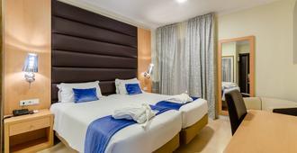 罗西奥因恩酒店 - 里斯本 - 睡房