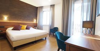 卡薩多蜜緹拉科爾平酒店 - 罗马 - 睡房