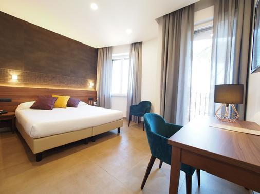 卡萨多蜜缇拉科尔平酒店 - 罗马 - 睡房