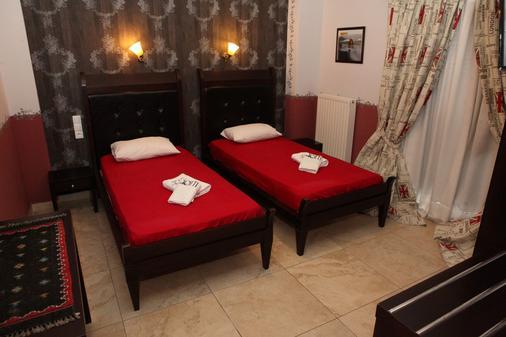 托蒂精品客房酒店 - 卡兰巴卡 - 睡房