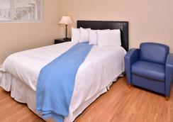 塔奇拉/西泰克机场美国最有价值旅馆及套房酒店 - 塔奇拉 - 睡房