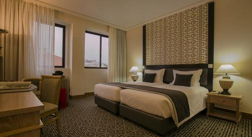 世界酒店 - 里斯本 - 睡房
