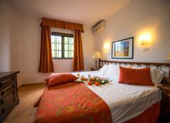 欧纳拉斯卡希塔斯酒店 - 普拉亚布兰卡 - 睡房