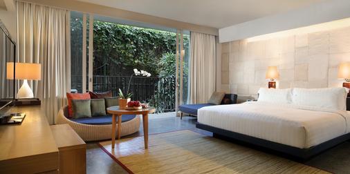 巴厘岛水明漾乌帕萨酒店 - 库塔 - 睡房