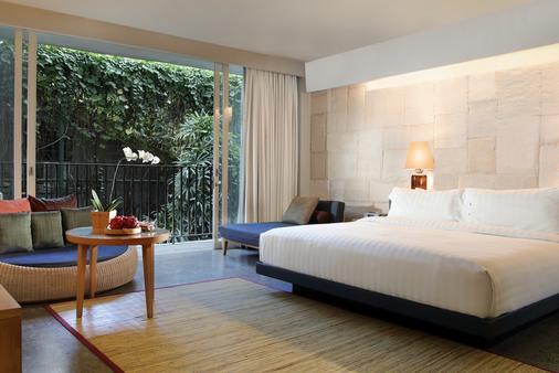 U 巴厘岛岛水明漾帕萨酒店 - 库塔 - 睡房