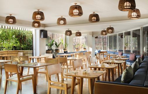 巴厘岛水明漾乌帕萨酒店 - 库塔 - 餐馆