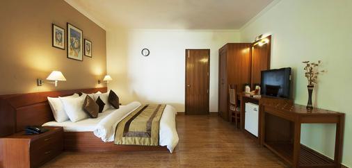 亚波诺加尔度假村 - 古尔冈 - 睡房