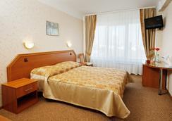观光客酒店 - Omsk - 睡房