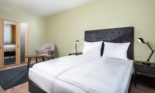 莱比锡市中心戴斯酒店 - 莱比锡 - 睡房
