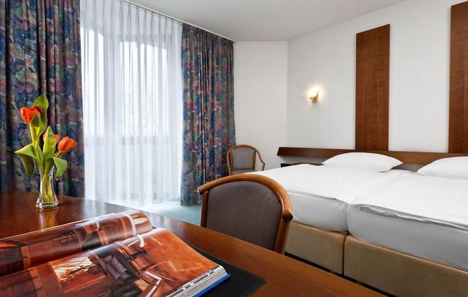 莱比锡博览中心温德姆戴斯酒店 - 莱比锡 - 睡房