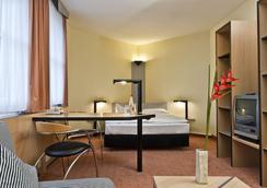 温德姆哈雷TRYP酒店 - 萨勒河畔哈雷 - 睡房