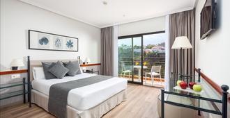 碧莱弗体验奥罗塔瓦酒店 - 拉克鲁斯 - 睡房