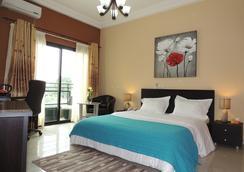 普雷萨德公寓式酒店 - Abidjan - 睡房