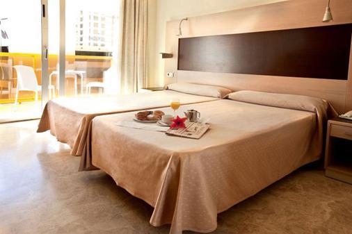 王朝酒店 - 贝尼多姆 - 睡房
