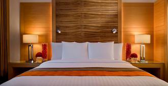 古茹格拉姆市中心万怡酒店 - 古尔冈 - 睡房