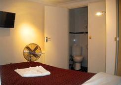 皇家伦敦酒店 - 伦敦 - 睡房