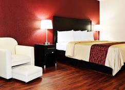 洞穴城红屋顶套房酒店 - 凯夫城 - 睡房