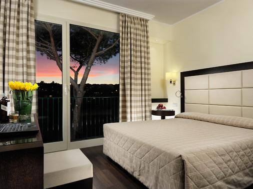 玛丽亚蕾佳娜别墅酒店 - 罗马 - 睡房