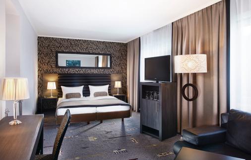 温德姆花园汉堡市中心柏林托尔酒店 - 汉堡 - 睡房