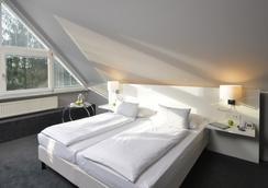 施瓦滕雷莱克萨沃德酒店 - 斯图加特 - 睡房