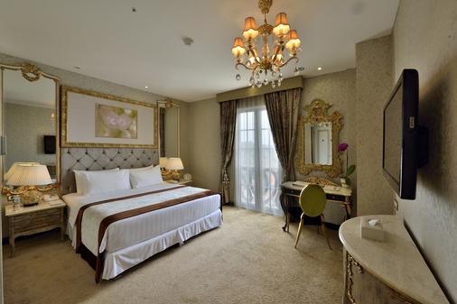 皇家阿玛罗莎酒店 - 茂物 - 睡房