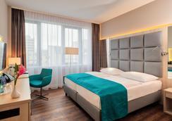 库弗斯登达姆好莱坞媒体酒店 - 柏林 - 睡房