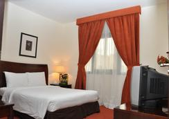 Danat Century Hotel Apartments - 阿布扎比 - 睡房