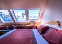 佩尔戈莱塞酒店 - 巴黎 - 睡房
