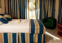 富特版画金沙酒店 - 尼格瑞尔 - 睡房