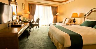 世纪公園飯店 - 马尼拉 - 睡房