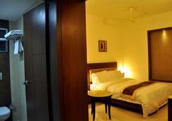 王子花园酒店 - 哥印拜陀 - 睡房