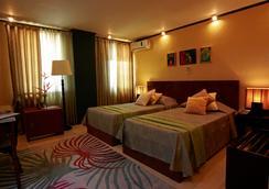 马尼拉庄园酒店 - 马尼拉 - 睡房