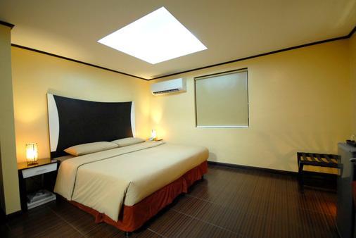 卡萨柏库宝酒店 - 马尼拉 - 睡房