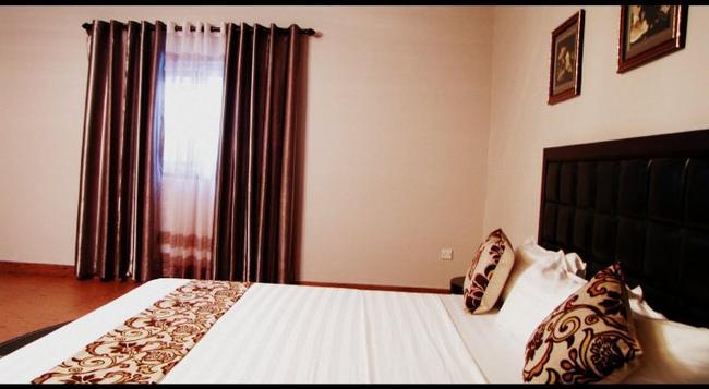 豪华套房酒店 - 阿克拉 - 睡房
