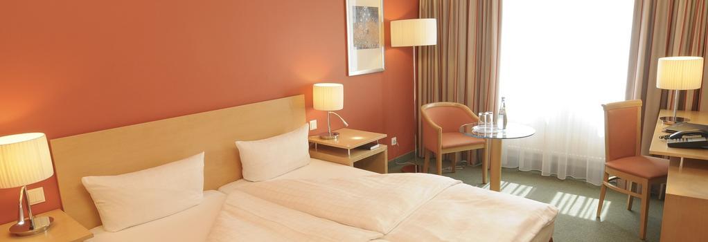 弗里德里希斯海英阿普斯达尔布姆酒店 - 柏林 - 睡房