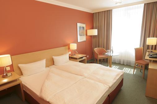 柏林弗里德里希斯海英阿普斯达尔布姆酒店 - 柏林 - 睡房