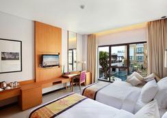 库塔大英娜酒店 - 库塔 - 睡房